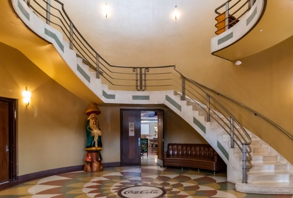 The restored entry to the Coke plant showing the terrazzo floor and the circular art deco staircase