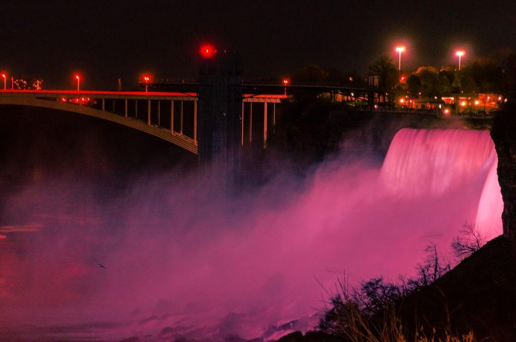 The illuminated American Falls at night