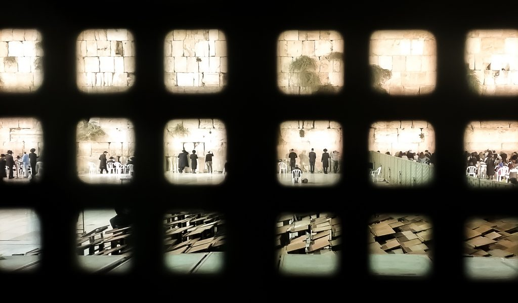 A view of the Western Wall through the decorative grillwork at the entrance