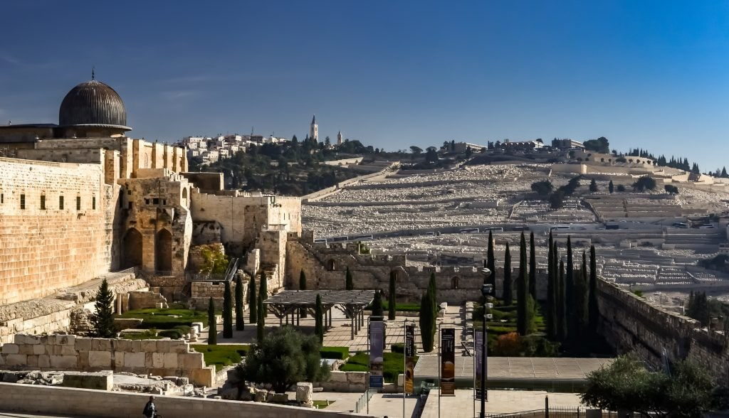 Our first view of the southern end of the Temple Mount , the Al Aqsa Mosque and the Mount of Olives in the distance