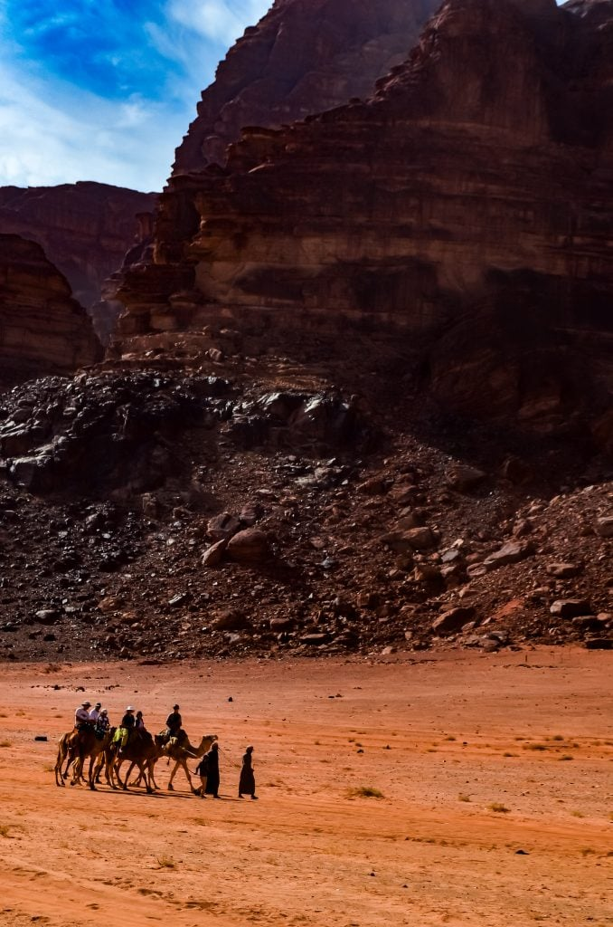 Other camel riders in the desert of Wadi Rum