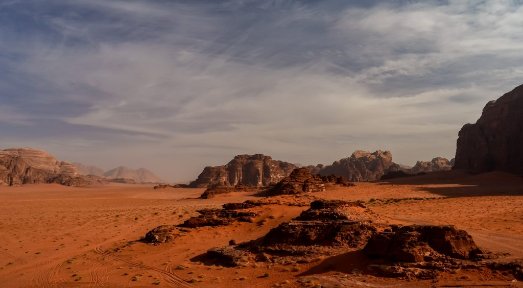 Wadi Rum is a beautiful combination of large sandstone c;iffs and sandy valleys