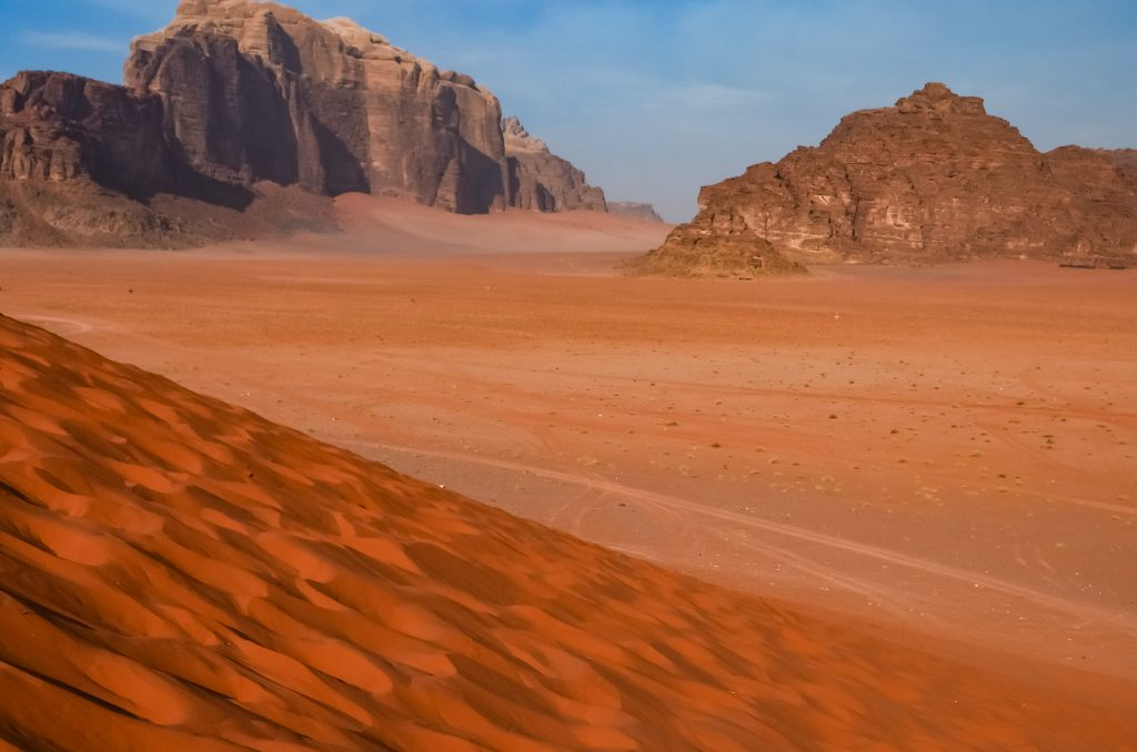 Looking out across Wadi Rum from the top of a big sand dune