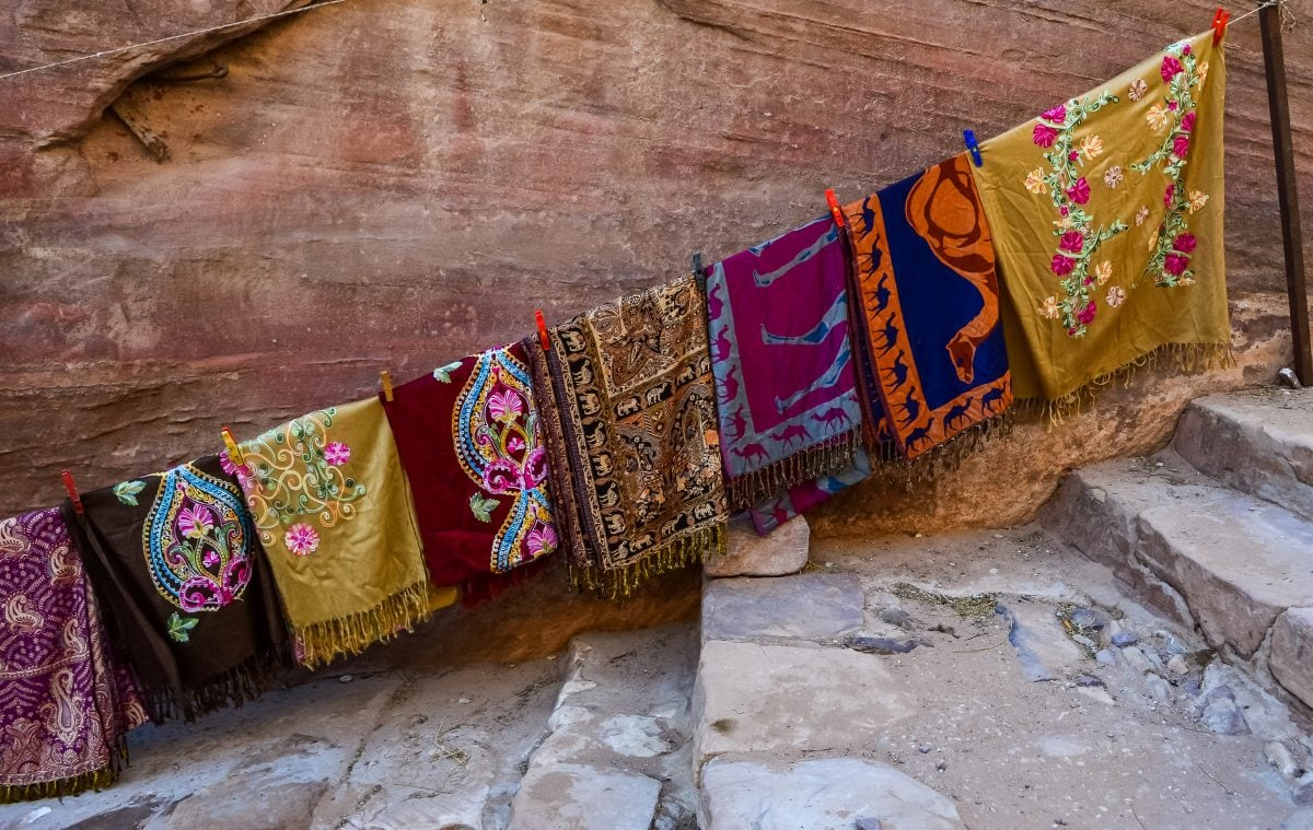 A display of scarves on the trail to the Monastery in Petra